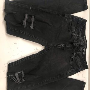 Women's distressed black jeans